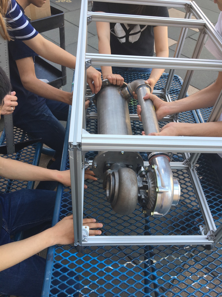 The team trying to attach the core to the engine frame, sponsored by 80/20 Inc.